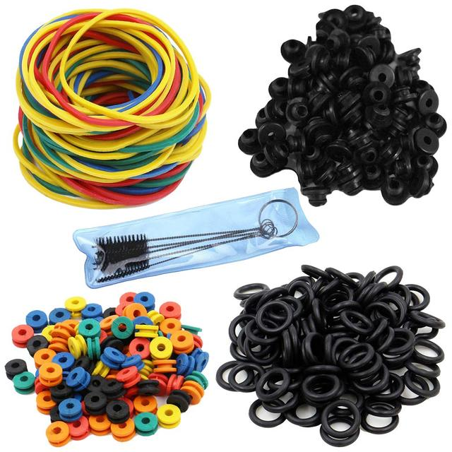 100pcs Tattoo Rubber Bands, 100pcs Tattoo O-rings, 100pcs Tattoo Grommets, 100pcs Tattoo Nipples & 1 set Tattoo Cleaning Brush