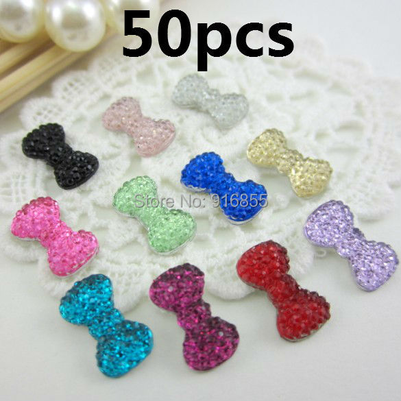 Free shipping new and fashion 50pcs/lot 12.5*7mm bow shape flatback resin rhinestone,resin cartoon for DIY decoration