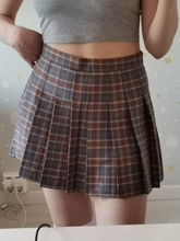I am 170 cm tall and weigh 55 kgs. I ordered a large but I'm usually a eu size 34 or a small/medium in skirts, so size up!! it fits almost perfectly which is really surprising, it's just a tiny bit big in the waist but that's totally fine. the length of the skirt is perfect, its a little bit short but it has really comfortable shorts underneath. I can't wait to wear this:) (oh and I got a pair of free earrings) would definitely recommend this seller considering I've bought skirts from other stores that were really really off.