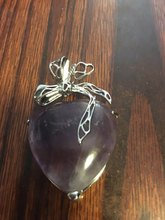 Fast delivery,  the pendant is big, but the purple color is very light and the amethyst has  a few cracks.